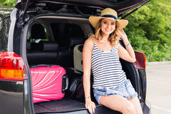 Vacation, Travel concept - young woman ready for the journey on summer holidays with suitcases and car Stock Photo