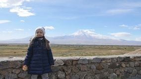 Portrait of vacation travel little girl looking at Ararat mountain landscape. Nature during summer vacations. Young kid. Vacation travel girl looking at Ararat stock video footage