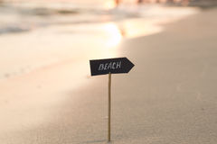 Vacation, travel or holidays idea - beach sign and sunset Royalty Free Stock Photo