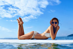 Vacation Travel. Summer Relax. Healthy Woman In Water. Recreational Sports. Vacation Travel. Summer Relax. Healthy Fit Woman With Body In Bikini Sunbathing royalty free stock photography