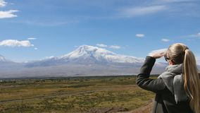 Vacation travel woman looking at Ararat mountain landscape. Nature during summer vacations. Young female standing at. Lookout looking at viewpoint in 4K stock video footage