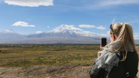 Vacation travel woman take photos of Ararat mountain landscape. Nature during summer vacations. Young female standing at. Vacation travel woman looking at Ararat stock footage