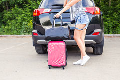 Vacation, Travel - young woman ready for the traveling. suitcases and car. Vacation, Travel - family ready for the travel for summer vacation. suitcases and car Royalty Free Stock Photography