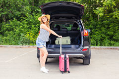 Vacation, Travel - young woman ready for the traveling. suitcases and car Royalty Free Stock Photos