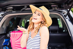 Vacation, Travel - young woman ready for the traveling. suitcases and car. Vacation, Travel - family ready for the travel for summer vacation. suitcases and car Stock Photos