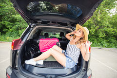 Vacation, Travel - young woman ready for the traveling. suitcases and car. Vacation, Travel - family ready for the travel for summer vacation. suitcases and car Royalty Free Stock Image
