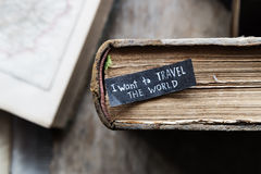 Vacation or trip idea, i want to travel the world text. I want to travel the world  inscription on the label, old books and maps Stock Photos