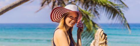 Vacation on tropical island. Woman in hat enjoying sea view from wooden bridge BANNER, LONG FORMAT. Vacation on tropical island. Woman in hat enjoying sea view stock images