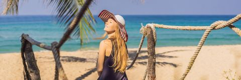 Vacation on tropical island. Woman in hat enjoying sea view from wooden bridge BANNER, LONG FORMAT. Vacation on tropical island. Woman in hat enjoying sea view stock photography