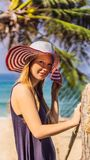 Vacation on tropical island. Woman in hat enjoying sea view from wooden bridge VERTICAL FORMAT for Instagram mobile. Vacation on tropical island. Woman in hat royalty free stock photography