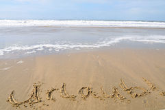 Vacation! Urlaub!. The word vacation in German: Urlaub, written in the sand of a beautiful beach stock photo