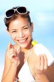 Vacation woman putting sunscreen Stock Photos