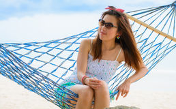 Vacation woman relaxing on beach in hammock on summer. Thai girl Royalty Free Stock Photography