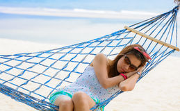 Vacation woman relaxing on beach in hammock on summer Royalty Free Stock Photos