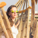 Vacation woman relaxing at the beach in hammock Royalty Free Stock Photo