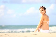 Vacation woman sitting on beach Royalty Free Stock Photography