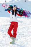 Vacation of woman with snowboard Royalty Free Stock Photography
