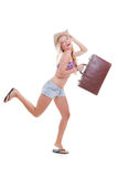 Vacation woman travel bag. Young woman with travel bag or case on summer holiday or spring break Stock Photos