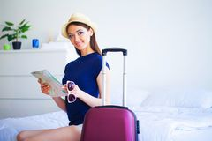 Vacation. Woman Who is Preparing for Rest. Young Beautiful Girl royalty free stock photos