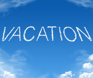Vacation - word cloud. Clouds forming the word vacation in the sky Stock Photo