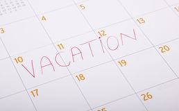 Vacation written on a calendar Stock Image