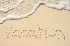 Vacation Written in Sand on Beach Royalty Free Stock Photos