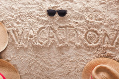 Vacation written in a sandy tropical beach Stock Photography