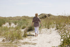 Vacationer in dune landscape Royalty Free Stock Image