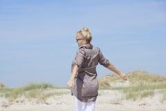 Vacationer enjoying the beach Royalty Free Stock Image