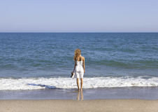 Vacationer overlooking the sea Royalty Free Stock Photo