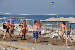 Vacationer playing volleyball on the private beach resort. Stock Photography