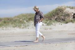 Vacationer walking on beach path Stock Photo