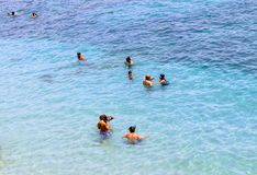Vacationers bathe in crystal clear water Alanya, Turkey Stock Photography