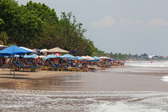 Vacationers on a beach, Bali, Indonesia Stock Photo