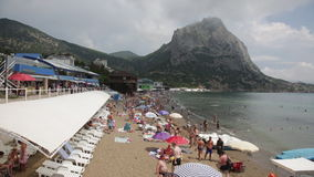 Vacationers on a beach in the Crimea stock video