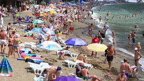 Vacationers on a beach in the Crimea stock video footage