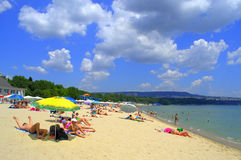Vacationers on the beach. Vacationers relaxing on summer beach,Varna ,Black sea coast,Bulgaria Stock Image