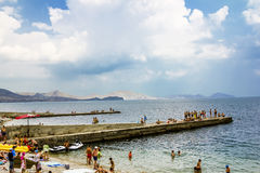 Vacationers on a City Beach in the settlement KOKTEBEL in Crime Stock Photography