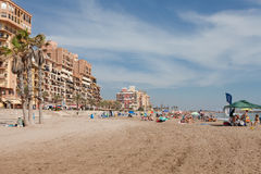 Vacationers on the city beach. Royalty Free Stock Image