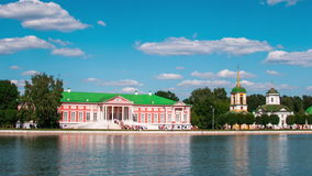 Vacationers go boating about Kuskovo palace. stock video