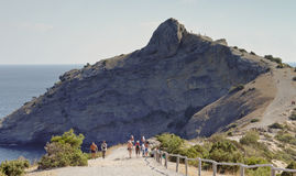 Vacationers go on a Hiking trail on Cape Kapchik.Crimea. Stock Photos