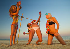 Limbo. Vacationers have fun doing the limbo Royalty Free Stock Images