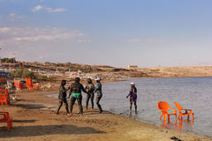 Vacationers in the mineral mud of the Dead Sea. Dead Sea, Biankini Beach, Israel - September 30: vacationers and tourists in the mineral mud of the Dead Sea, on Stock Photo