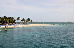 Vacationers at Palomino. Beachgoers enjoy the white sandy beach on the island of Palomino, Puerto Rico Stock Photography