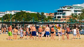 Vacationers play beach games at the seaside resort stock image