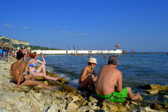 Vacationers relaxing on Balchik beach. Vacationers on the beach of Bulgarian town Balchik Stock Images