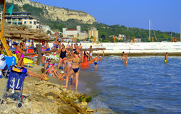 Vacationers relaxing on Balchik beach Royalty Free Stock Photography