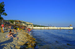 Vacationers relaxing on Balchik beach Stock Photo