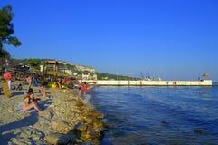 Vacationers relaxing on Balchik beach. Vacationers on the beach of Bulgarian town Balchik Stock Photo