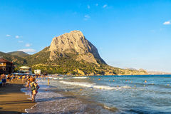 Vacationers on sea beach in Crimea Stock Images